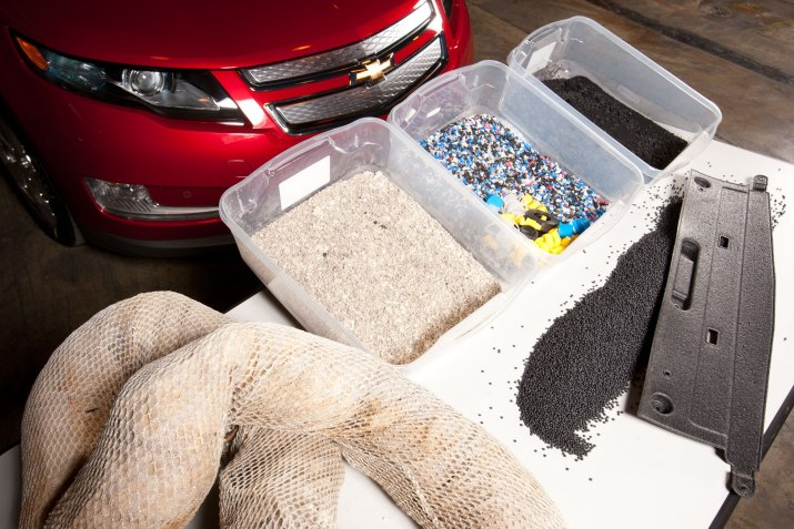 General Motors announces it has developed a method to convert oil-soaked, plastic absorbent booms floating in the Gulf of Mexico into parts for the Chevrolet Volt. The combination of these materials (l to r): recovered boom material, shredded and densified boom material, post consumer plastic and recycled tires from GM's Milford Proving Ground