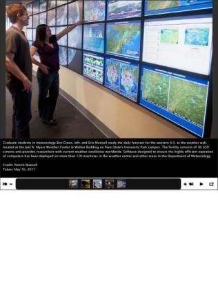 Credit: Patrick Mansell Graduate students in meteorology Ben Green, left, and Erin Munsell at the Joel N. Myers Weather Center in Walker Building on Penn State's University Park campus. Software designed to ensure the highly efficient operation of computers has been deployed on more than 120 machines in the Department of Meteorology.