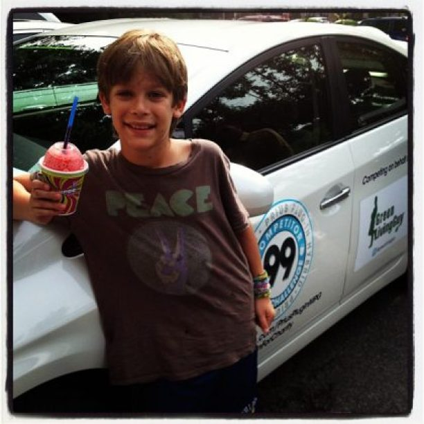 After a long day at camp my son Cameron is here holding a slushee. All part of the @toyotausa fun @pluginforcharity #pluginforcharity