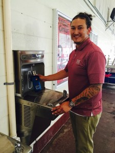 José Cerna NMSU  closeup using reusable bottle at elkay water fountain