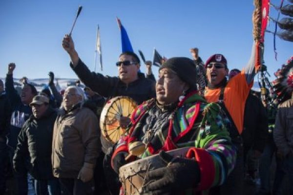 Protestors celebrate at Oceti Sakowin Camp earlier today. The Army Corps of Engineers notified the Standing Rock Sioux that the current route for the Dakota Access pipeline will be denied. Jim Watson/AFP/Getty Images