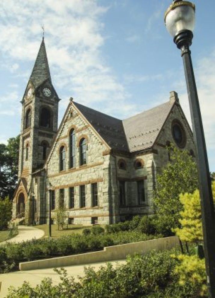 Built in 1885, the Old Chapel is the most iconic and significant historic building on the UMass Amherst campus. Designed by Steven C. Earle in the Richardsonian Romanesque style, the building originally housed a library, auditorium, natural history collections and classrooms. It was later used as a drill hall, departmental offices and finally as home to the Minuteman Marching Band in the 1960s, before officially closing its doors in 1999 due to structural deterioration.