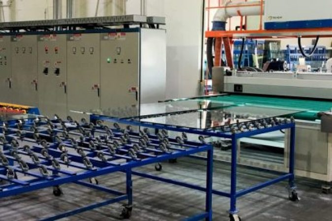 Glass moves to tempering machine after horizontal wash at Triview Glass