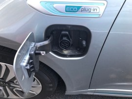Plugin hybrid electric car charging door
