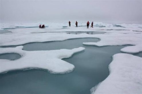 Scientists on Arctic sea ice in the Chukchi Sea, surrounded by melt ponds, July 4, 2010. NASA/Kathryn Hansen
