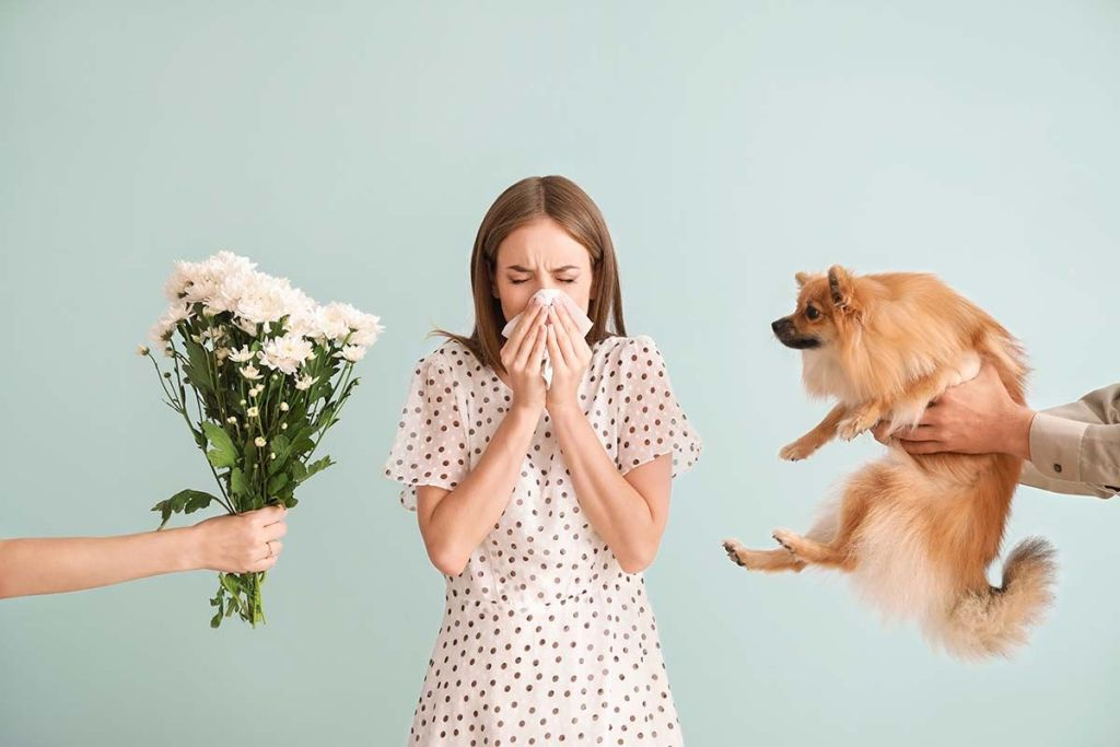 woman sneezing to dog and flower allergies