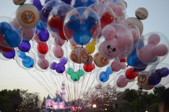 Huge Bouquet of Disneyland Balloons in front of Sleeping Beauty Castle at Dusk