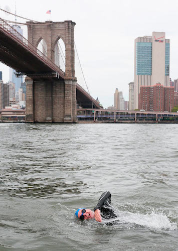 Activist Swimmer Christopher Swain Takes on the East River. Via Brooklyn Paper