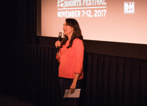Caryn Coleman introducing the Fest's opening night program