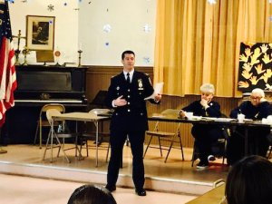 Captain Glynn at December's Community Council Meeting. Via Twitter
