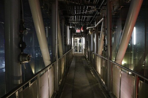Looking down one of the enclosed catwalks that connects one digester egg to another at the Newtown Creek Wastewater Treatment Plant. Photo: Megan Penmann
