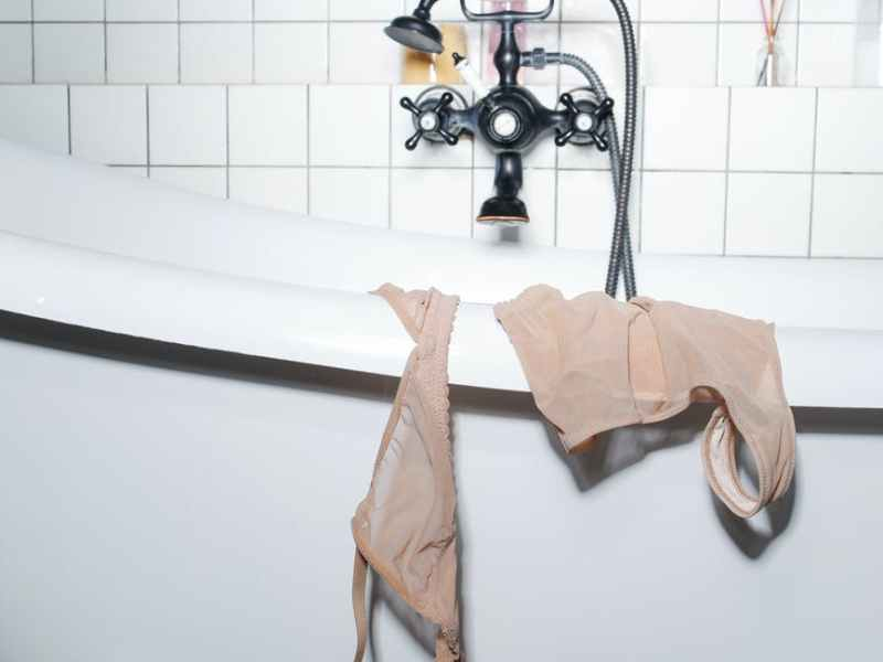 pink towel on stainless steel shower head