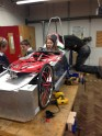 Working on the chainreaction CR14 f24 greenpower car in the workshop at chipping sodbury school