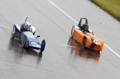 Two greenpower cars fighting for control.