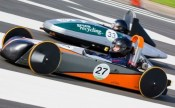 2 of the greenpower cars racing to win.