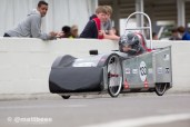 Lydia racing down the pit straight Goodwood Motor Circuit Greenpower heats