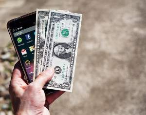 Mobile Phone and Dollar Bills