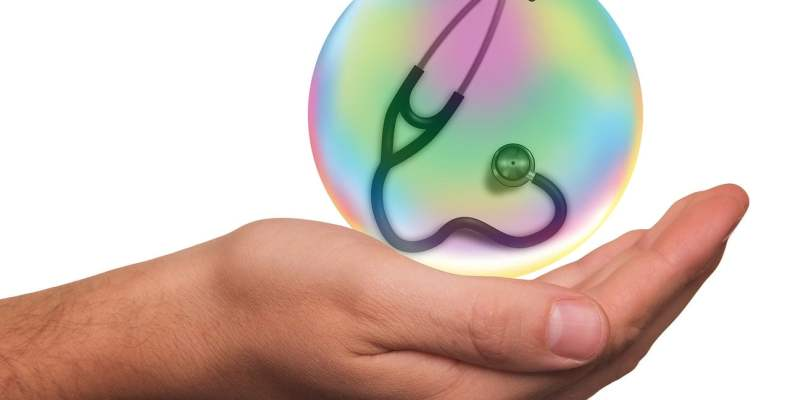 Hand Holding Stethoscope In Bubble