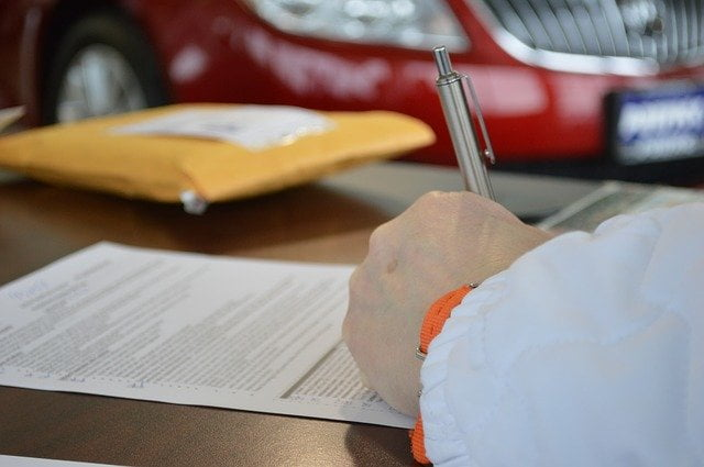 Signing Contract in Car Dealer