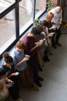 Line of People Using their Phones