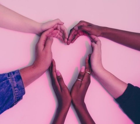 Group of Hands Making Heart