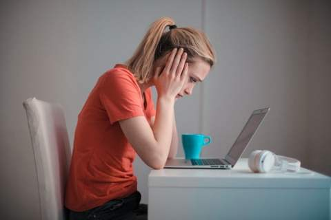 Woman Stressed on Laptop