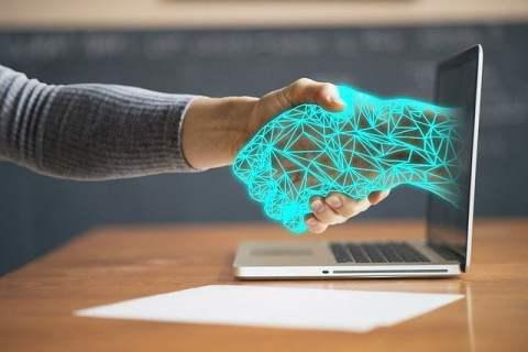 Handshake Through Computer Screen with Digital Hand