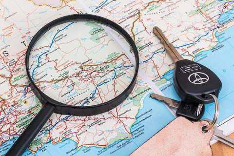 Paper Map with Magnifying Glass and Car Keys