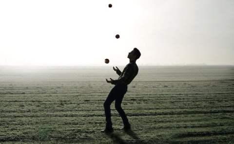 Man Juggling in Field
