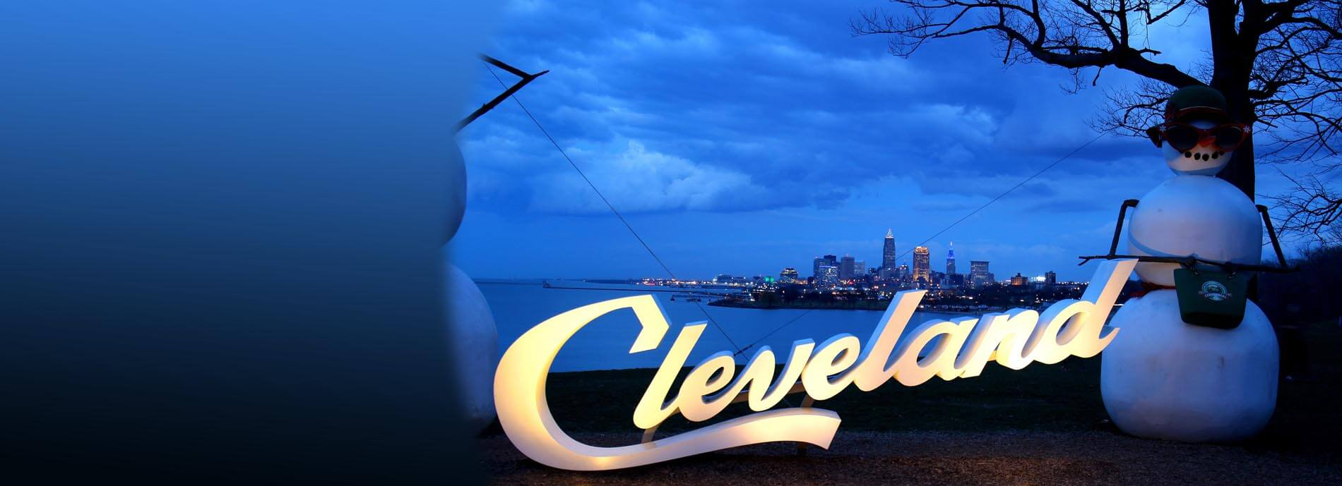 Cleveland slide - sign over lake, city in background