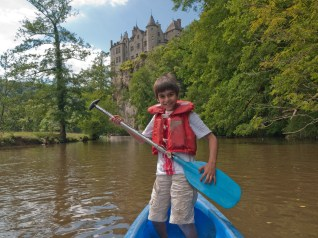 Sebastian canoeing on the Lesse river in the Ardennes, Belgium