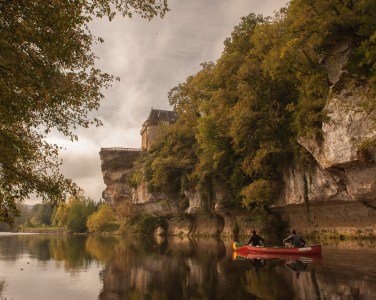 Approaching the Chateau de Belcayre on the Vezere river, Perigord, France with Nancy & Mitch