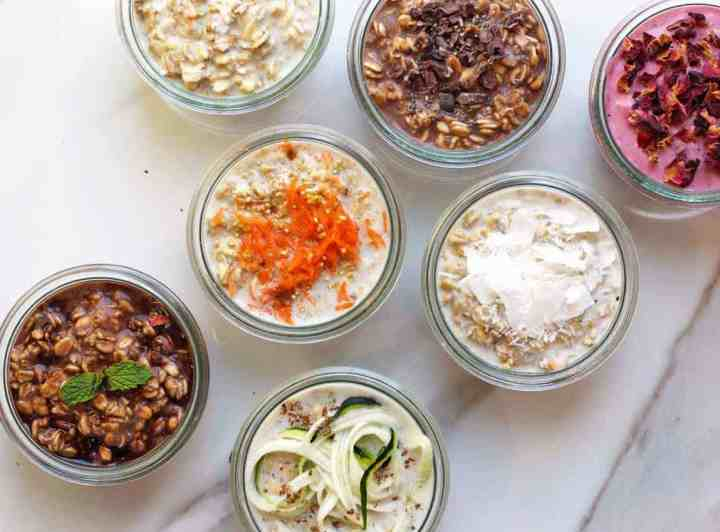 chia overnight oats recipes in jars in different flavors on a marble board.