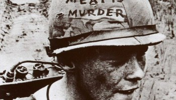 The social impact of the meat industry. The image depicts a soldier with the words Meat is Murder written on his helmet. The image was used on the cover of The Smiths' 1985 album, Meat is Murder.