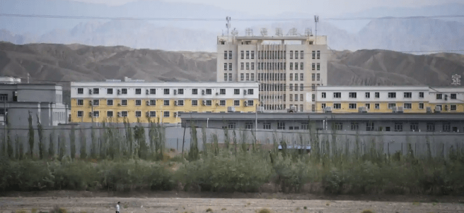 How to help the Uyghurs. A large facility that resembles a prison photographed in Xinjiang.
