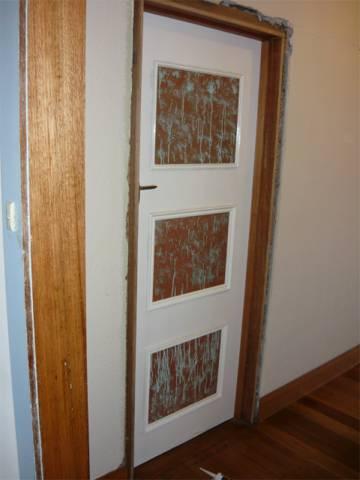 finished door hung on bedroom 2 door frame