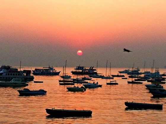 Arrive from Elephanta Caves in time for sunset in Mumbai harbor.