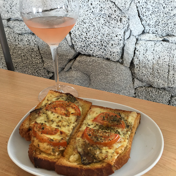 Simple lunch of local cheese, eggplant, tomato, bread and rosé