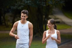 Sport couple walking in the summer park