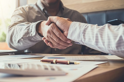 Greeting new colleagues team, business people shaking hands during a meeting to sign agreement and become a business partner, Successful businessman handshake after good deal for both companies