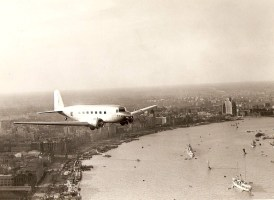 CNAC's first DC-2 over the Shanghai Bund on her maiden flight, 1935