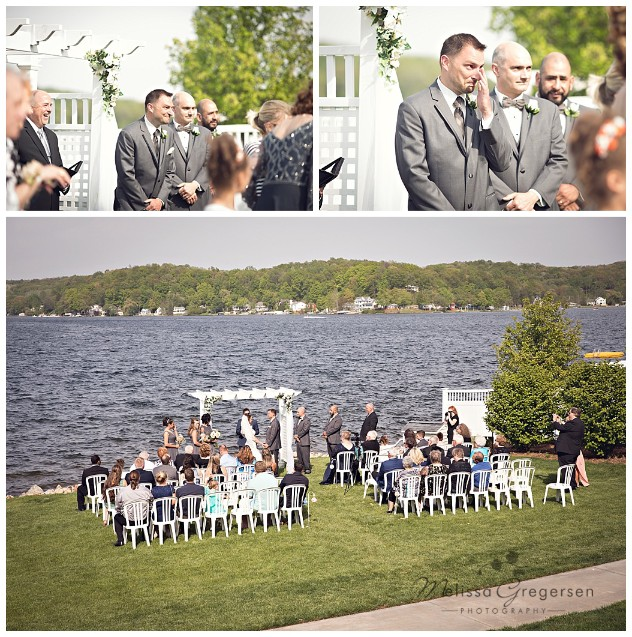 Groom's reaction to seeing his bride for the first time walking down the aisle at Bay Pointe Inn on Gun Lake photographed by Melissa Gregersen Photography