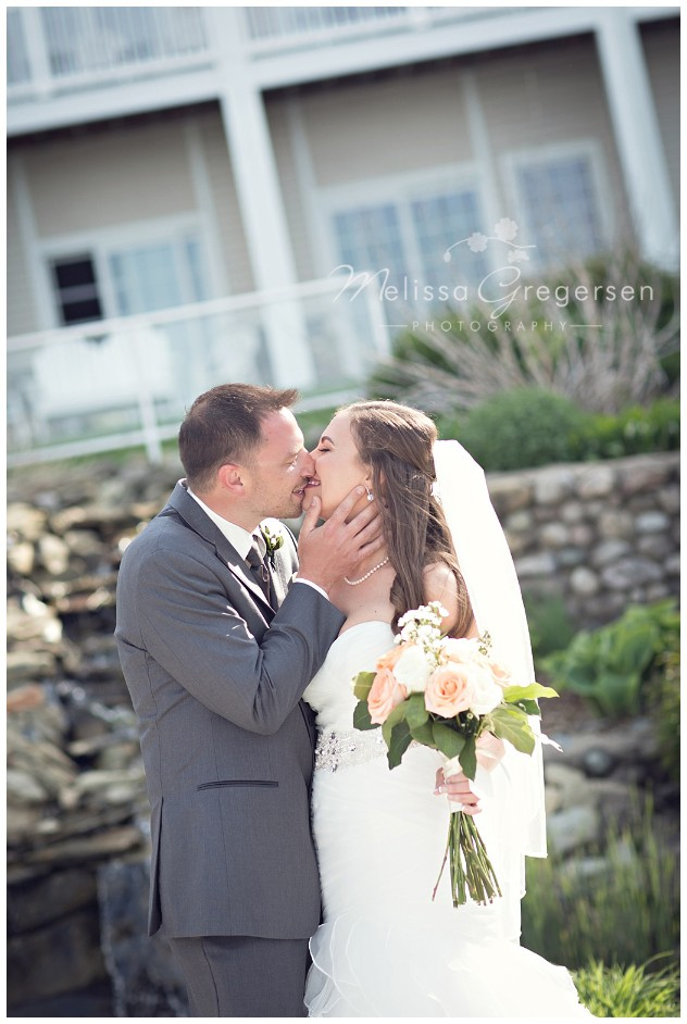 kisses and all smiles on their wedding day at Bay Pointe Inn on Gun Lake photographed by Melissa Gregersen Photography