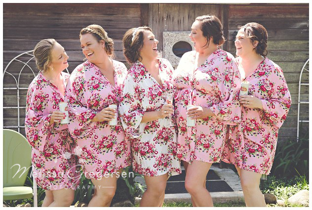 Bridesmaids have all the fun in their cute floral robes at the vintage rose barn