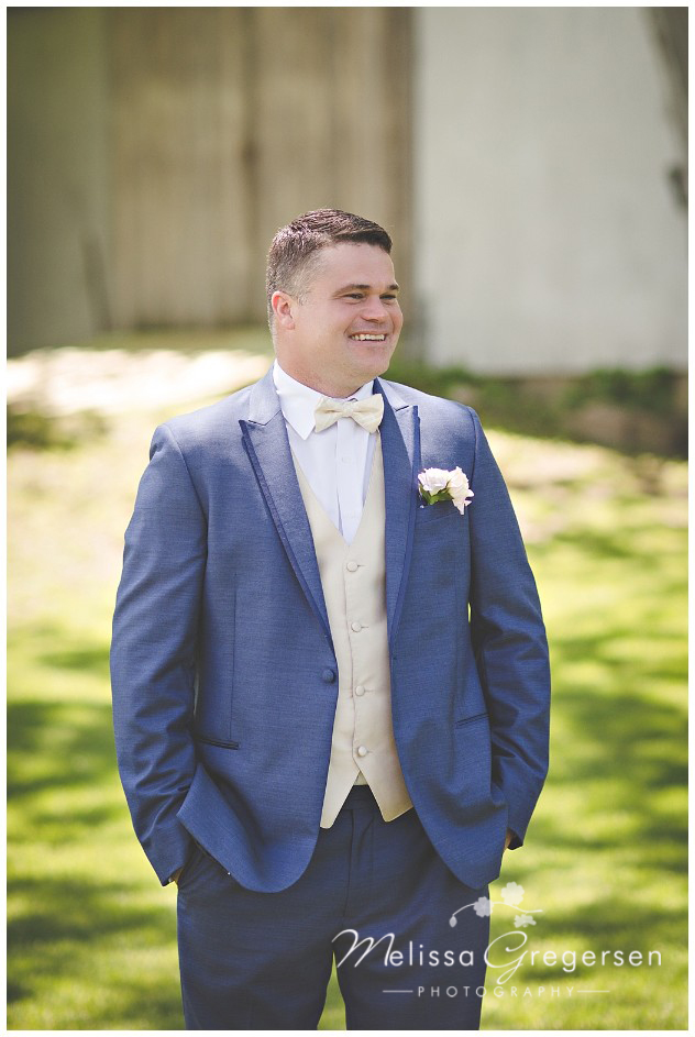 Million dollar grin from the groom looking at his bride