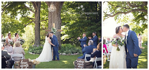 First kiss as husband and wife under the chandelier in the trees at the vintage rose barn