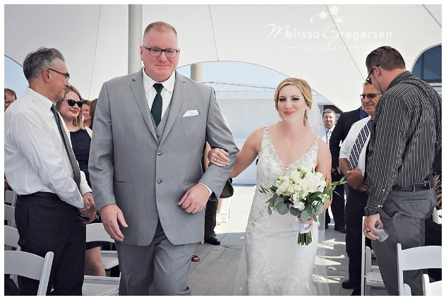 Such a proud daddy walking his daughter down the isle.