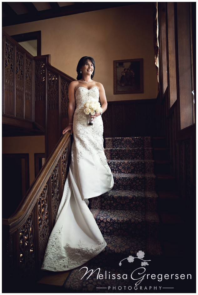 The dark wood staircase shows off the brides brilliant white dress perfectly!