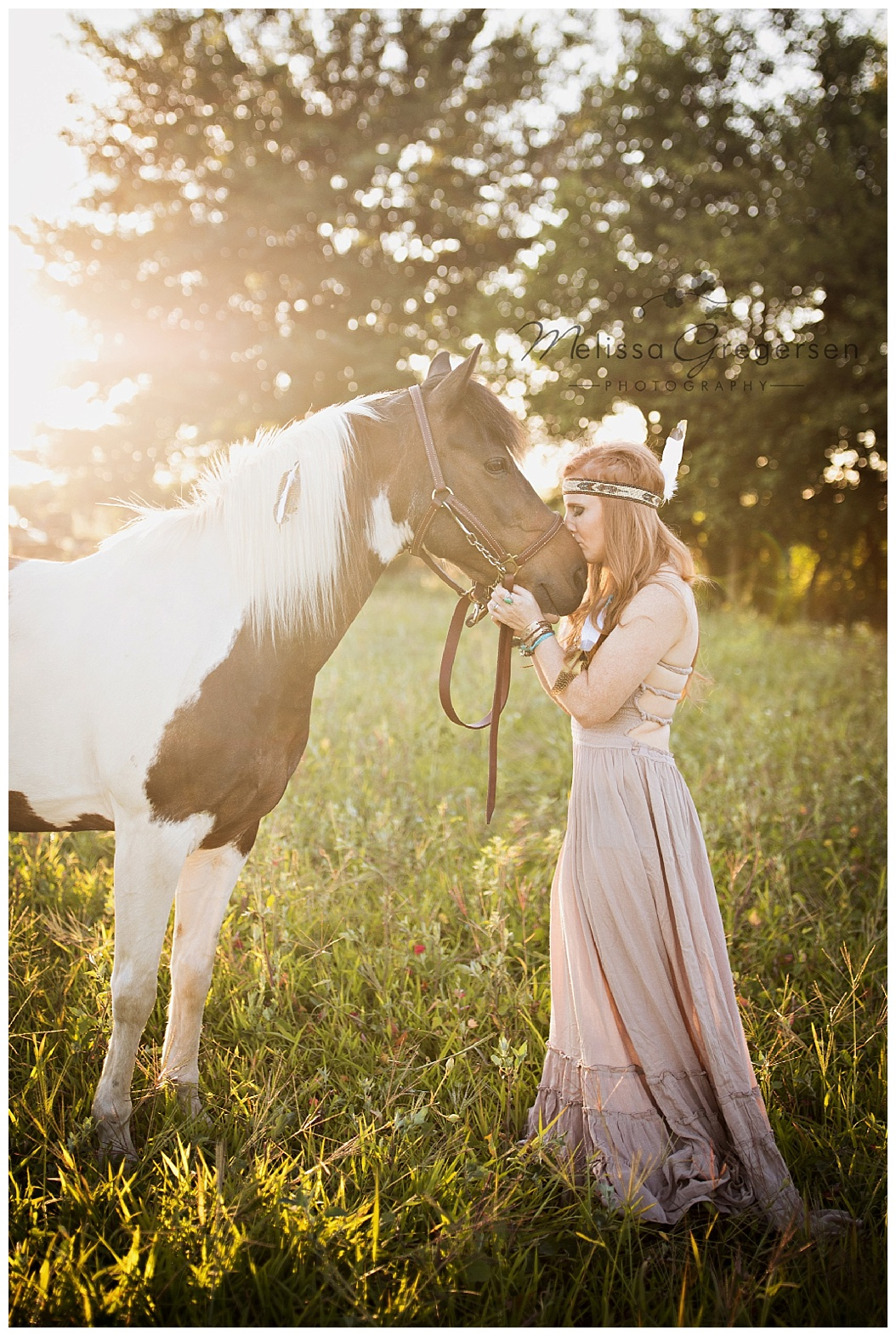 The sun glare really sets off this image of a horse and it's faithful human companion.