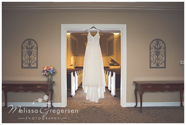 The doorway of the sanctuary was a great spot for this bride's dress picture!
